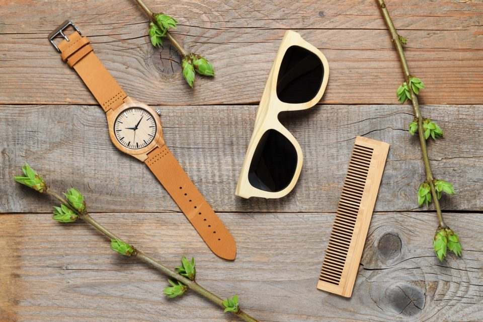 Eco-friendly plastic-free bamboo objects on wooden background