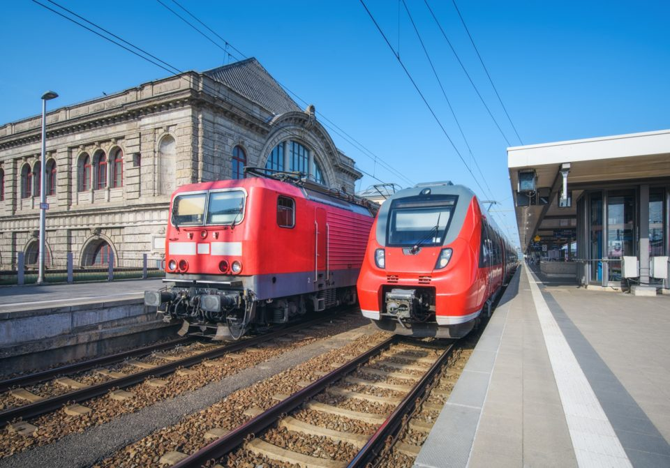 High speed train and old train on the railway station
