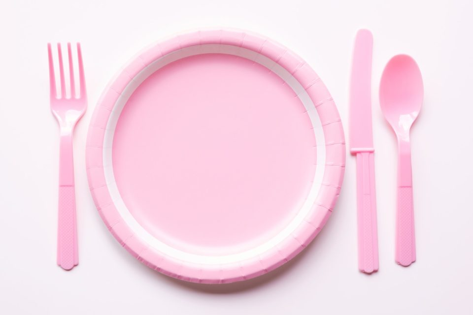 Pink color paper plate with plastic spoon, fork and knife