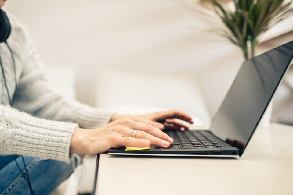 Woman working from home on laptop computer