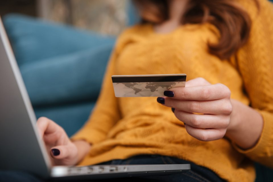 Close up of a woman buying online with bank card