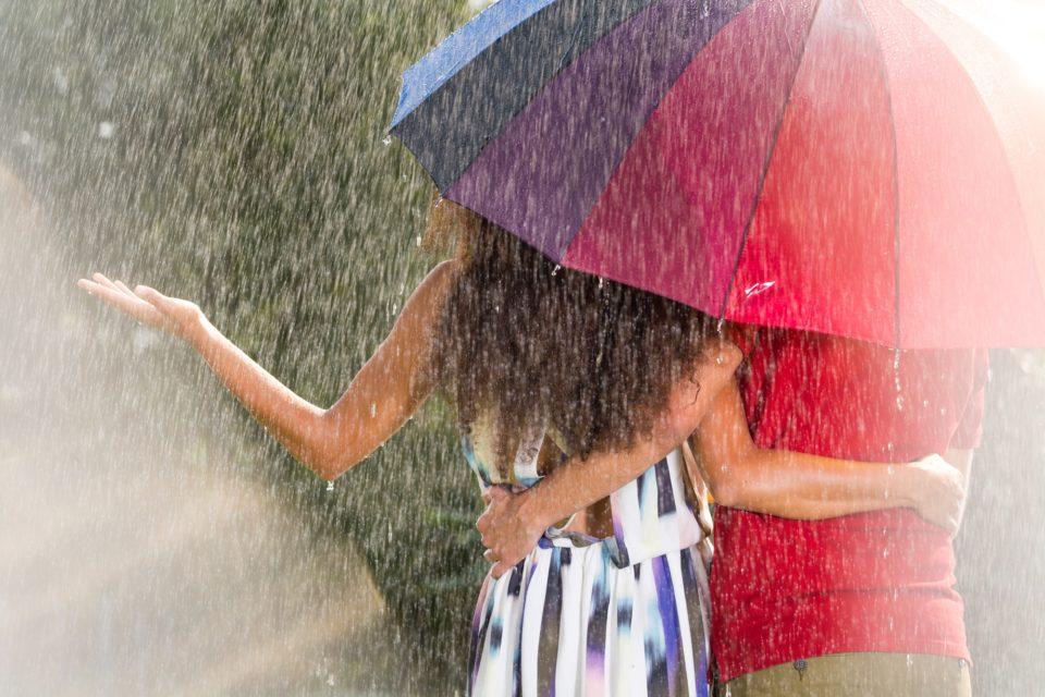 Man and woman under umbrella