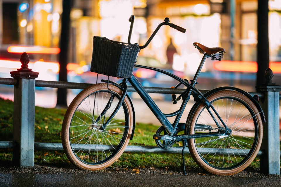 Bicycle Equipped Basket Parked In European City Street In Night