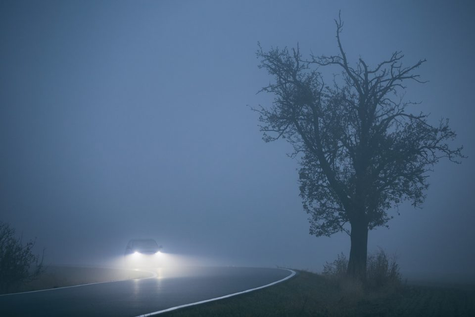 Car in thick fog