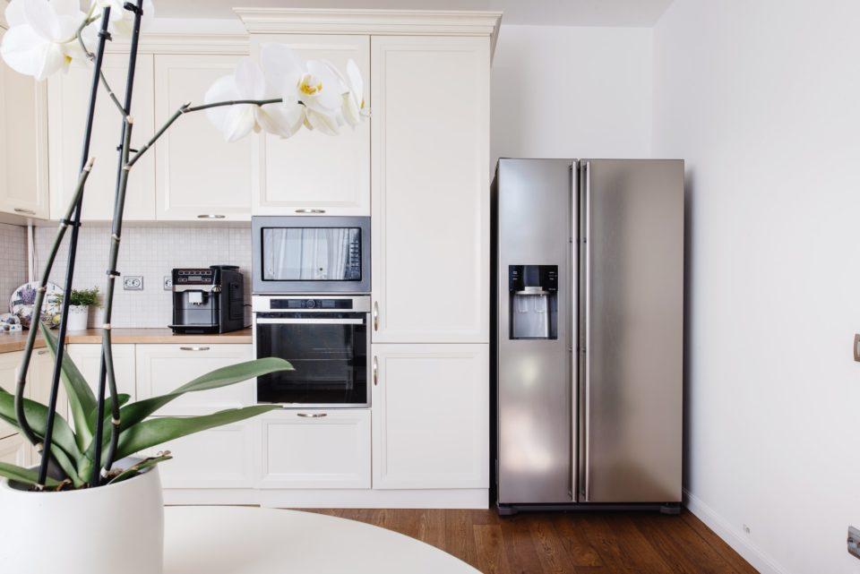 Modern appliances and new design in kitchen. Loft kitchen and apartment