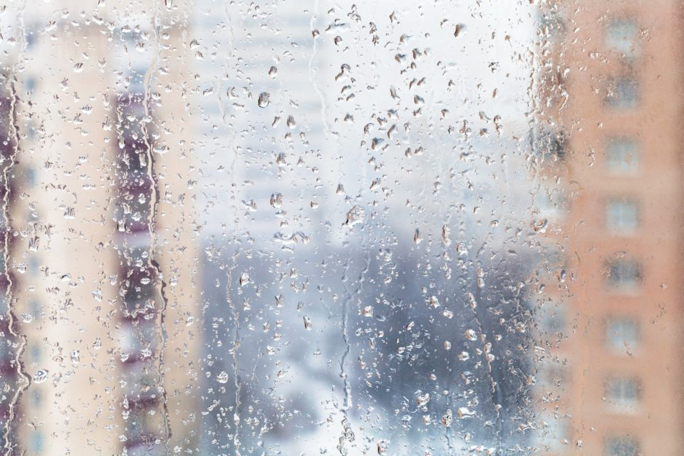 rain drops on home window glass in winter