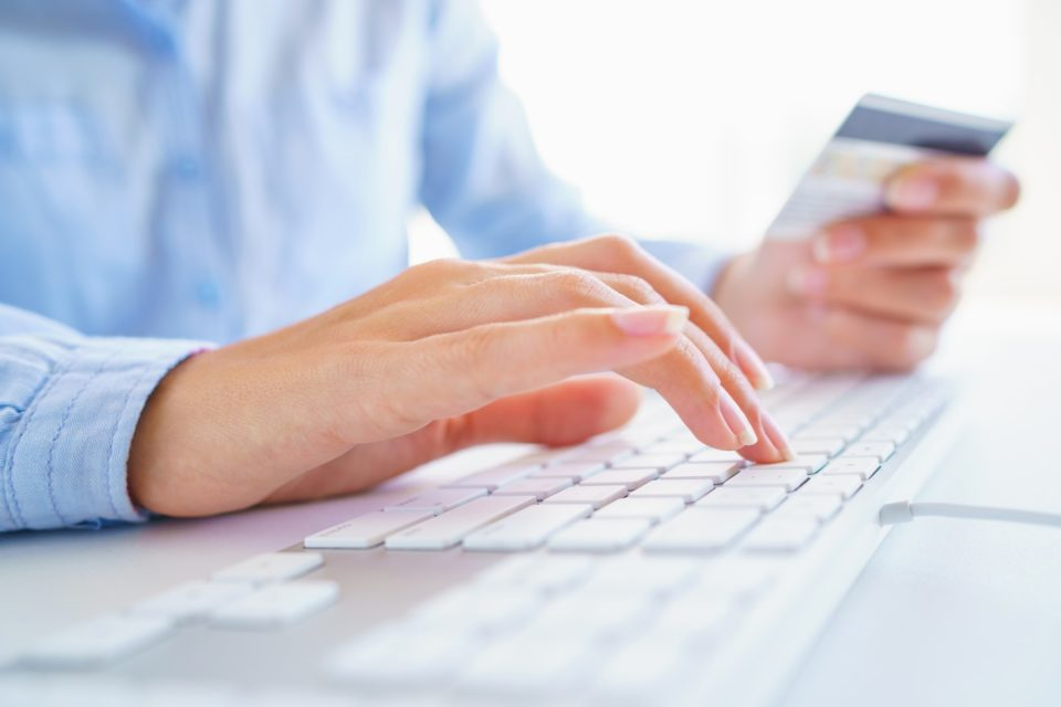 Woman using a credit card for online payments. The concept of on