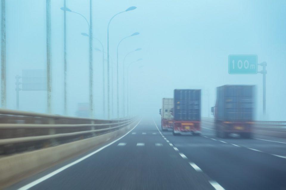 container trucks in fog