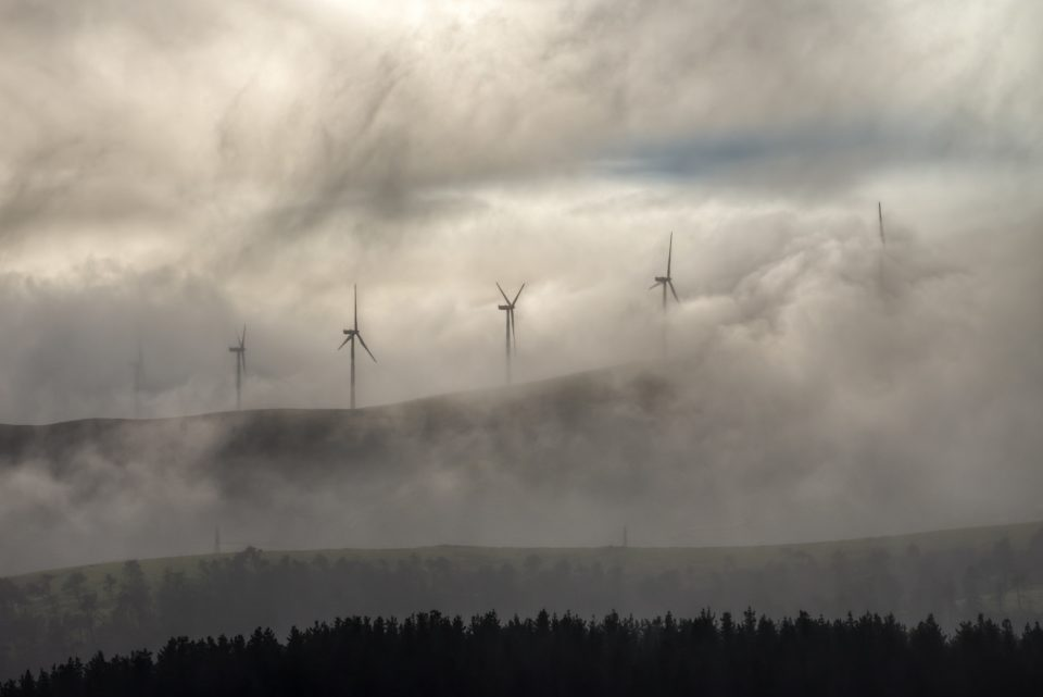 Wind turbines of a wind farm in the fog