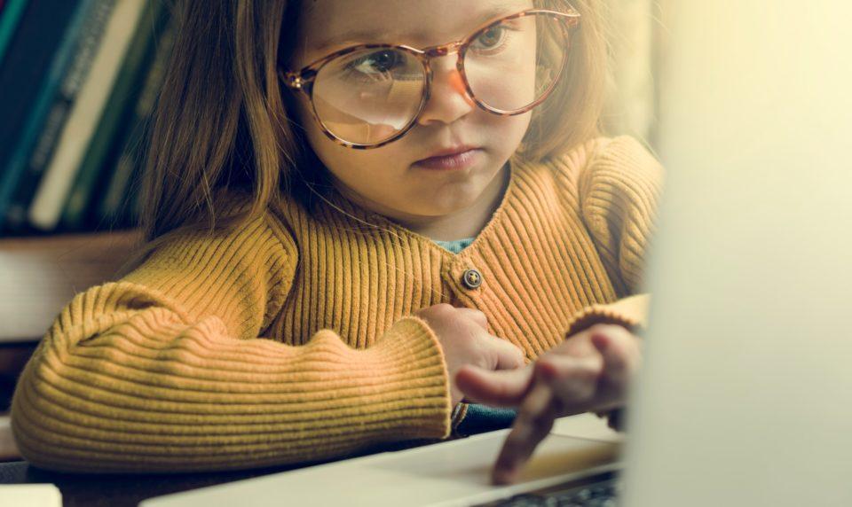 Little Girl Using Digital Laptop E-learning Concept
