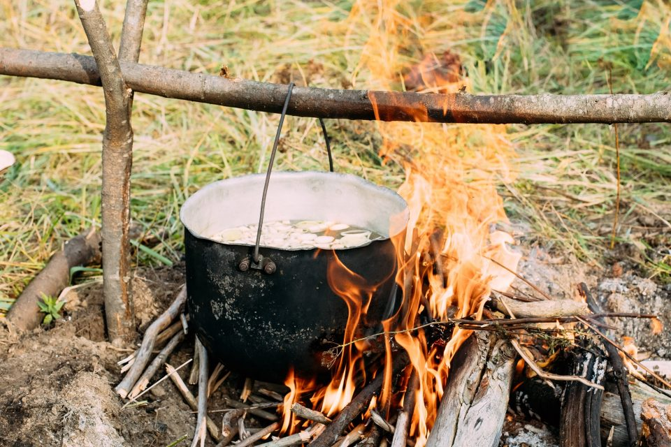 Old Camp Saucepan Boiled Water For Soup Preparation On A Fire In