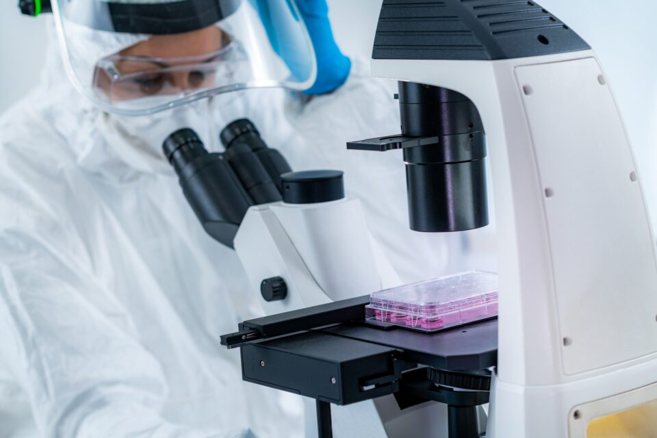 Corona Virus Vaccine Research, Scientist Working in the Laboratory, Looking Through the Microscope