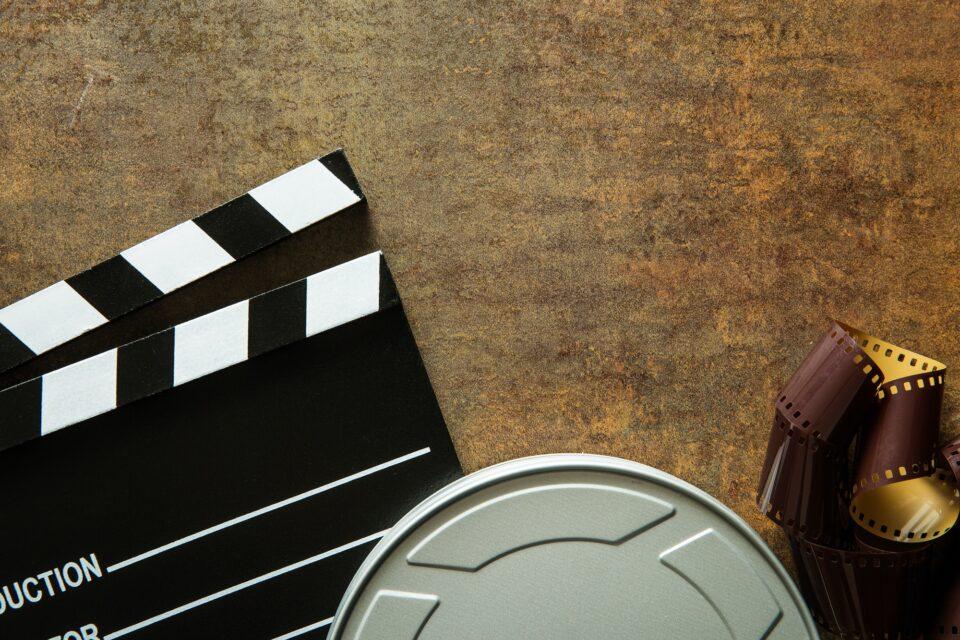 Clapper board with film reel.
