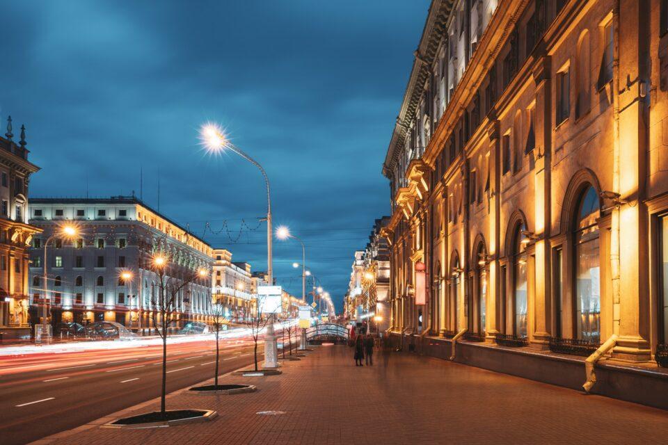Minsk, Belarus. Traffic On Independence Avenue In Evening Night