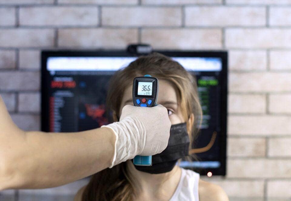 doctor measuring temperature