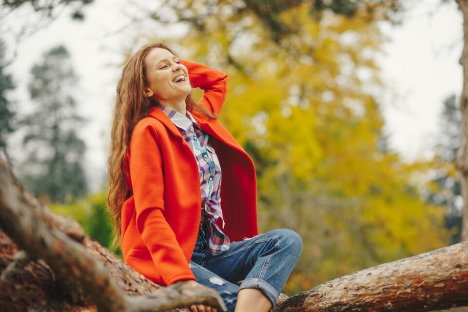 Smiling girl autumn portrait.