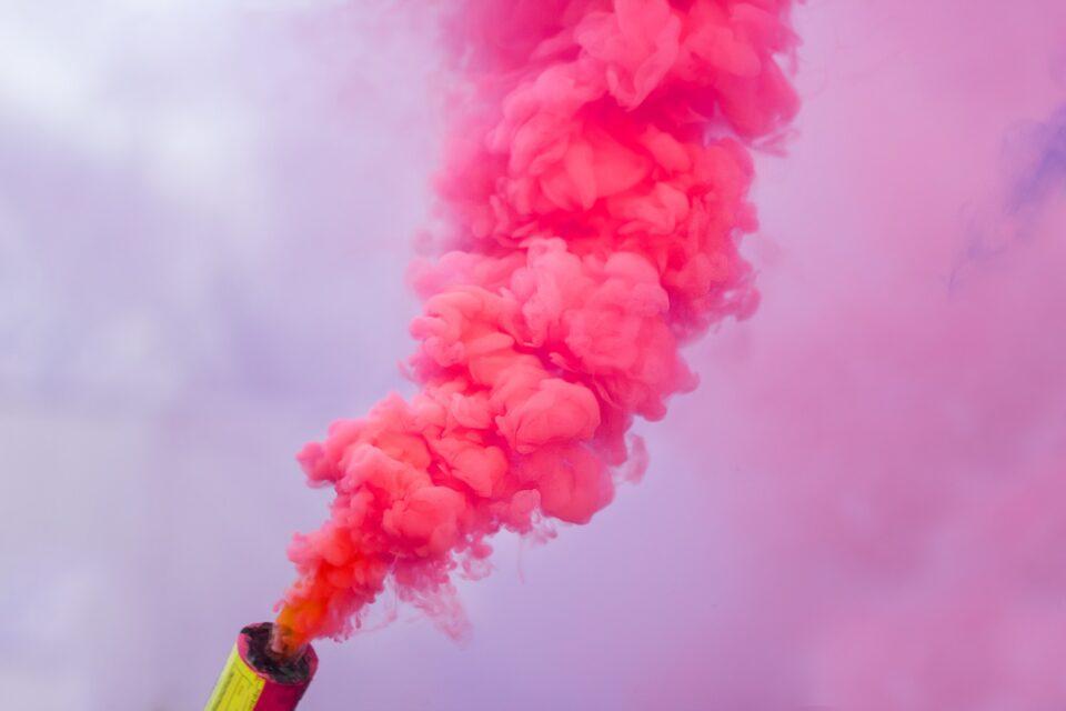 pink smoke bomb .festival color smoke signal burning