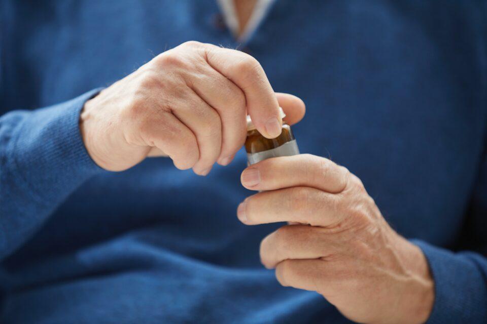 Senior Man Holding Pill Bottle