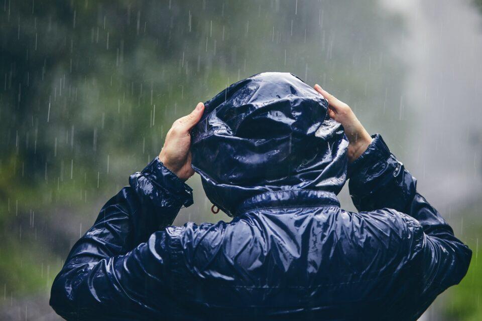 Traveler in heavy rain